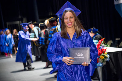 Image of 2015 grad holding diploma