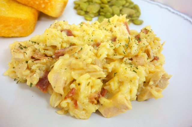 Baked Cracked Out Chicken and Rice recipe - chicken, cheddar, bacon, ranch, rice, cream of chicken soup and milk. Mix together, cover and bake. Ready in about 30 minutes! Everyone LOVES this super easy weeknight dinner recipe!!