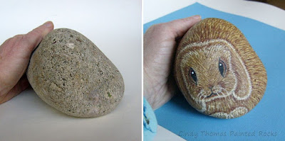 Rabbit with Floppy Ears hand painted on a stone by Cindy Thomas