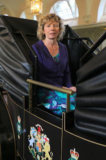 Rachel in the replica landau in the State Stables, Royal Mews, Buckingham Palace