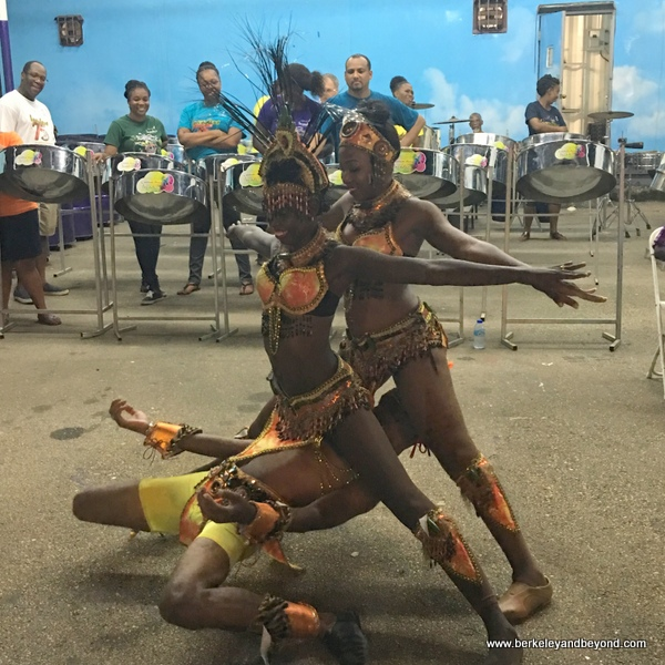 Darron Scotland of the Les Coteaux Folk Performers calypso dancers performs a delicate maneuver at a pan yard in Trinidad