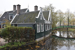 Houses painted in traditional deep green, Zaanse Schans, Zaandam, The Netherlands