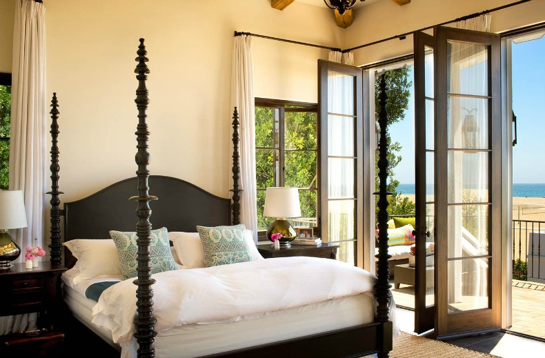 Coastal bedroom with four poster bed and beautiful ocean view
