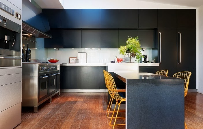 Modern black kitchen with yellow chairs