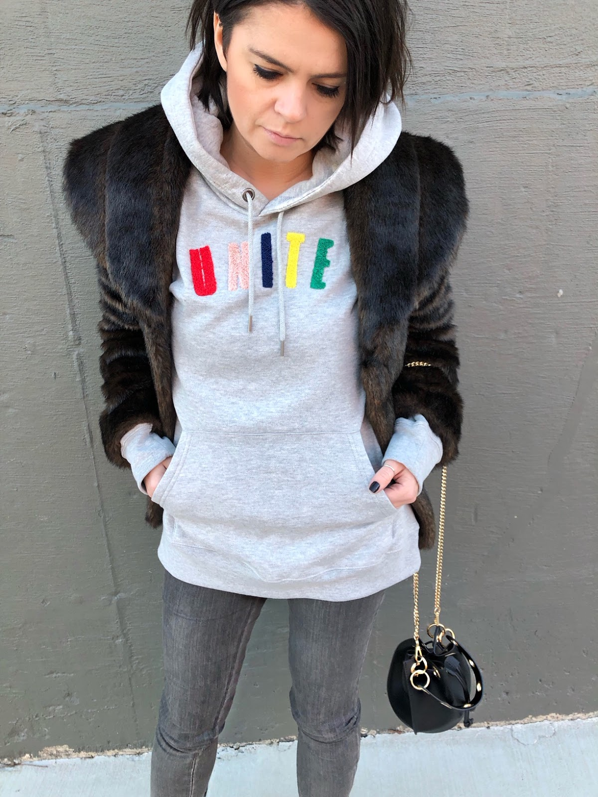A gray sweatshirt with colorful UNITE graphic