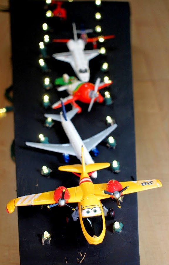 Make your own cardboard airport runway with your kids!