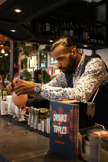 A barman at Tamatanga Leicester prepares cocktails at the bar