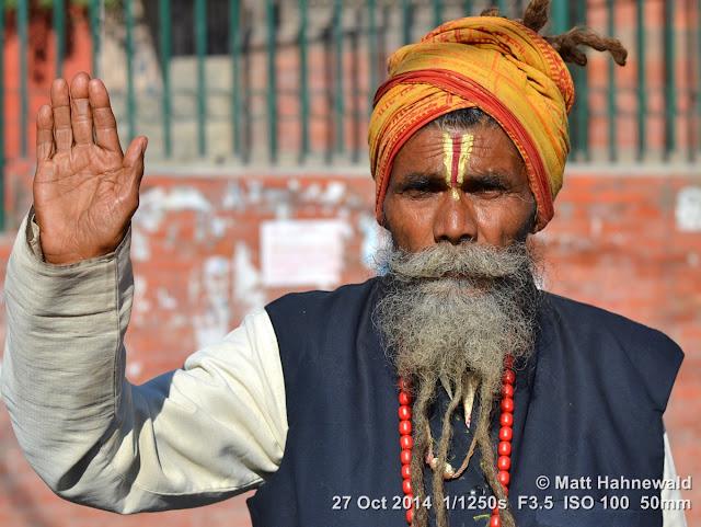 people, closeup, street portrait, Nepal, Kathmandu, sadhu, Hinduism, holy man, religious ascetic, yogī, mokṣa, raised right hand, blessing