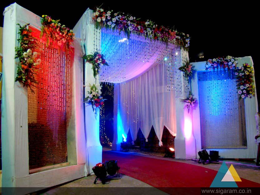 Sigaram wedding stage decorators in pondicherry chennai we also provide extra accessories such as beading small mirrors crystals or seashells from the top of the arch junglespirit Choice Image