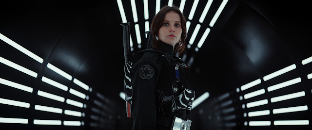 Jyn Erso in the awesome trailer shot.  Wearing the black armor of an Imperial trooper, staring into the camera, as the hallway illuminate behind her.