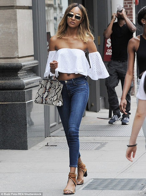 Jourdan Dun flaunting her midriff in an off-the-shoulder ilac lace top.