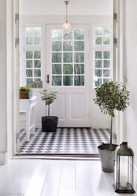Swedish style neutral black and white entry with checks on floor and plants - found on Hello Lovely Studio