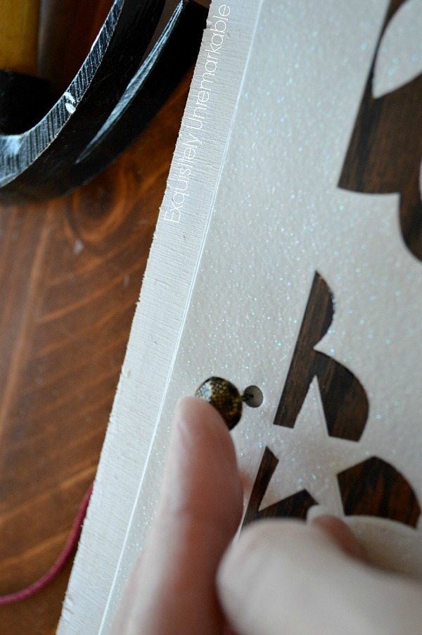 Adding a tack to a wooden board
