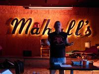 Photo of Ray McNiece reading at Mahall's