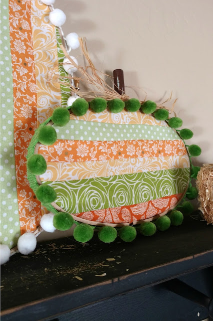 Embroidery hoop pumpkins made with oval hoops make for a fun and unique piece of fall decor!