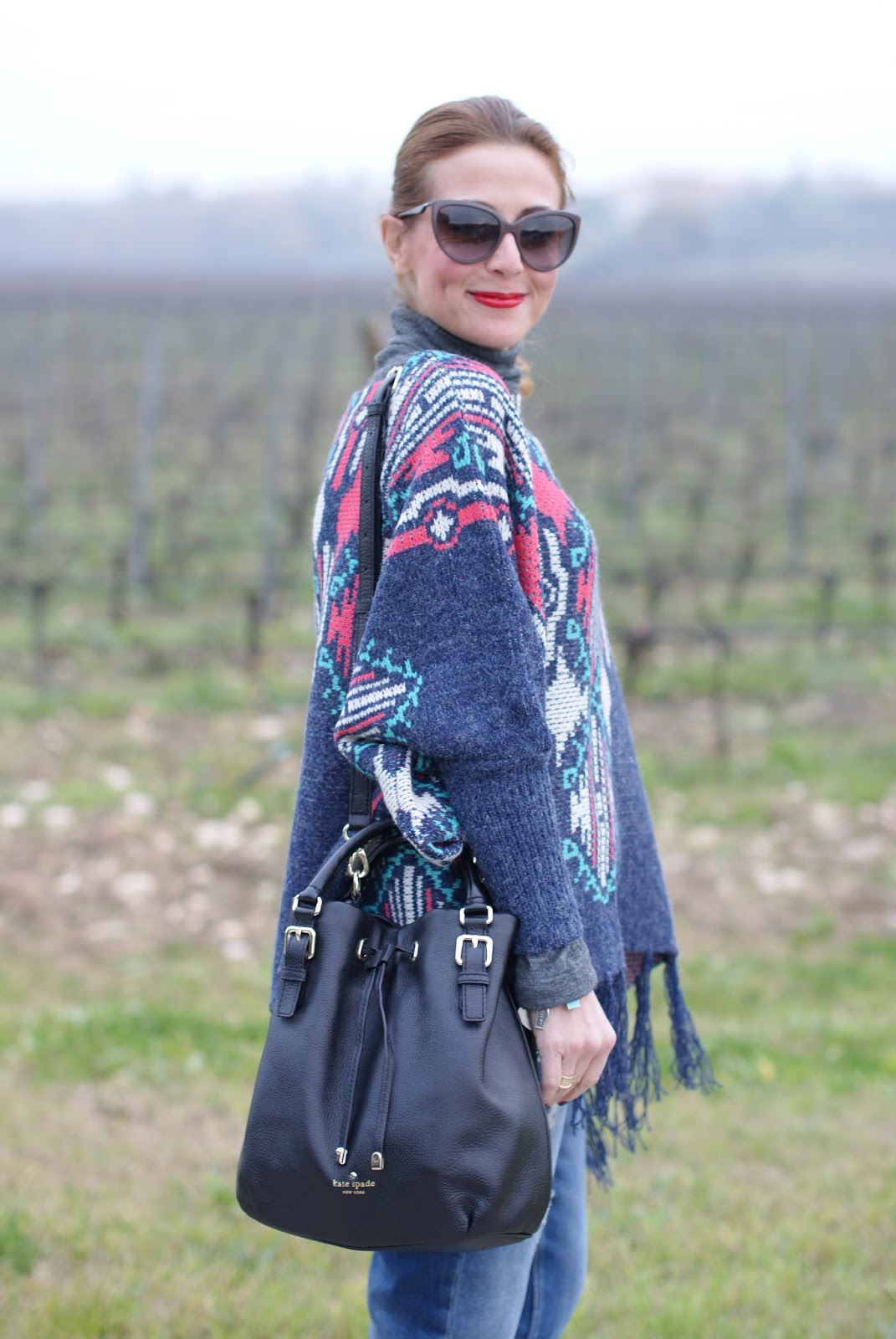 LucLuc Fringed aztec poncho for a western inspired outfit on Fashion and Cookies fashion blog, fashion blogger style