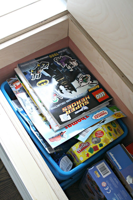 Window seat storage holds a ton of stuff!