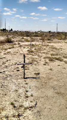 Three wooden crosses for unknown graves at the Old Pecos Museum.