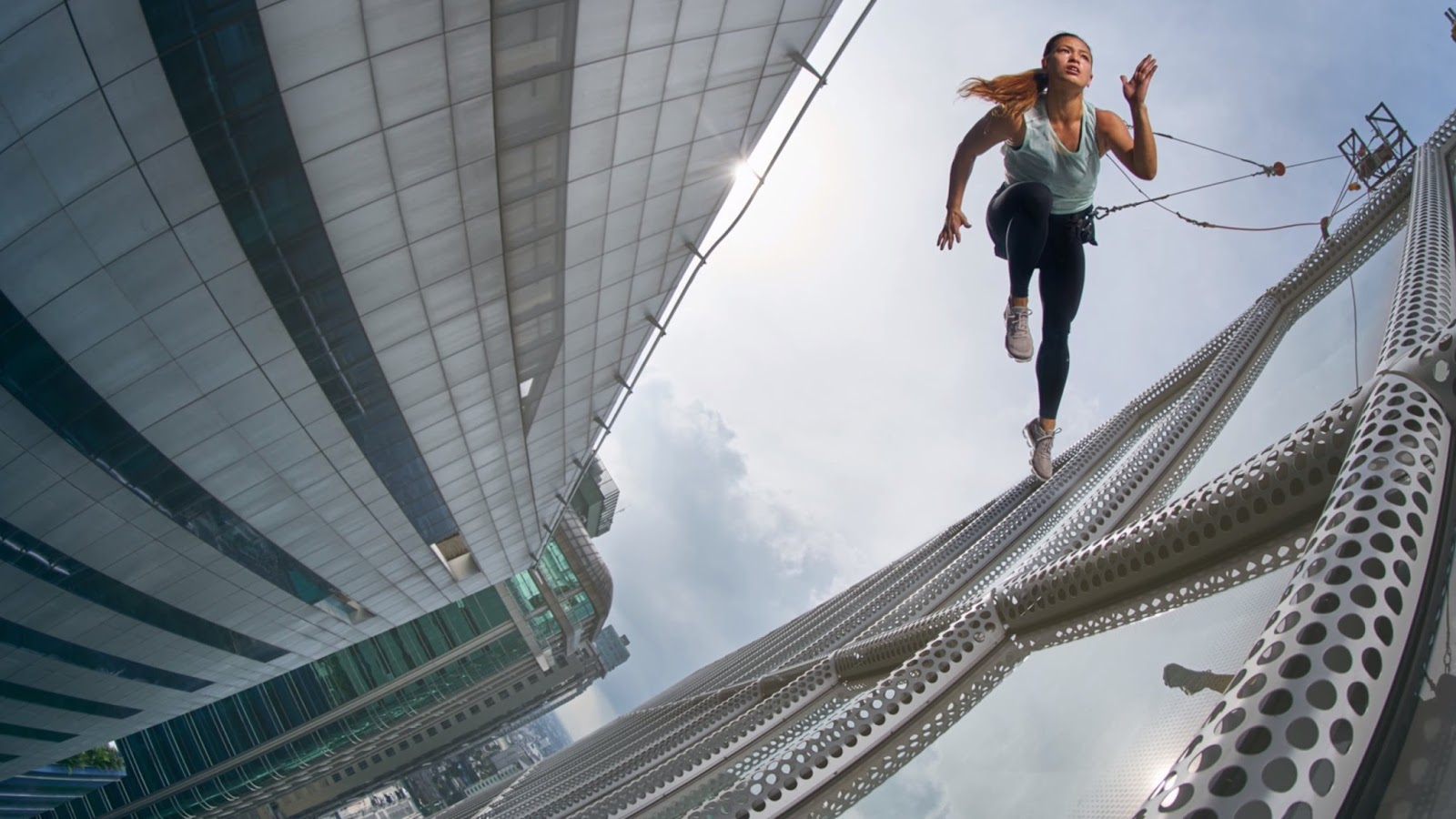 Stunt photoshoot off skyscraper with everyday atheletes