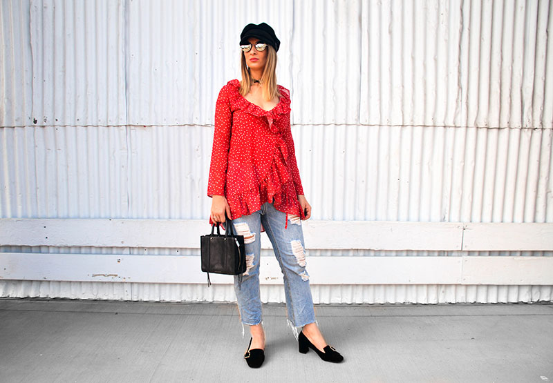 street style inspiring wrap blouse look red star print wrap top distressed jeans baker boy hat heeled loafers