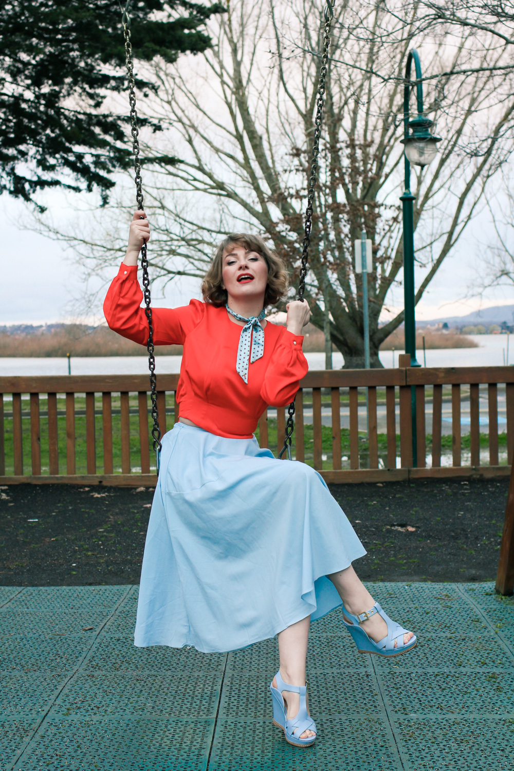 @findingfemme wears ice blue and orange red Chicwish outfit