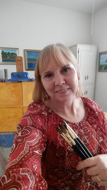 Amber Palomares Artist with Brushes
