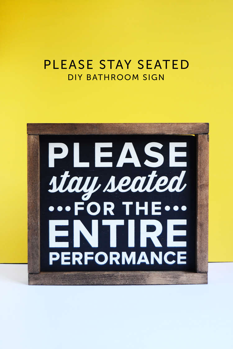 please stay seated bathroom sign