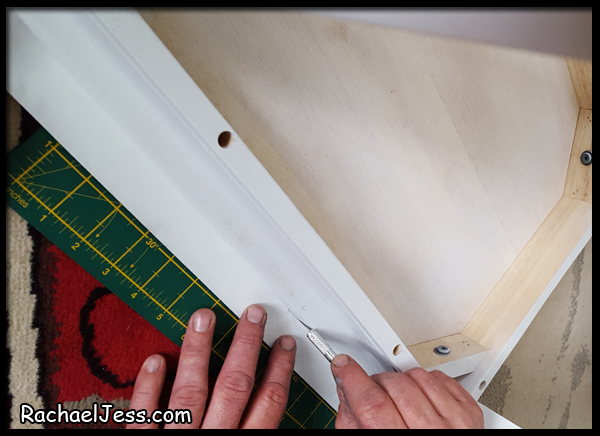 Trim the edge of the vinyl with a craft knife