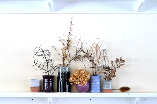 small vases with dried weeds