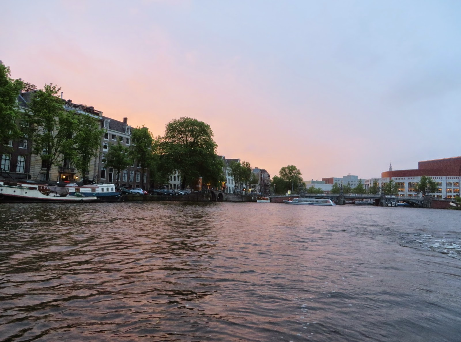 Amsterdam canal cruise sunset river