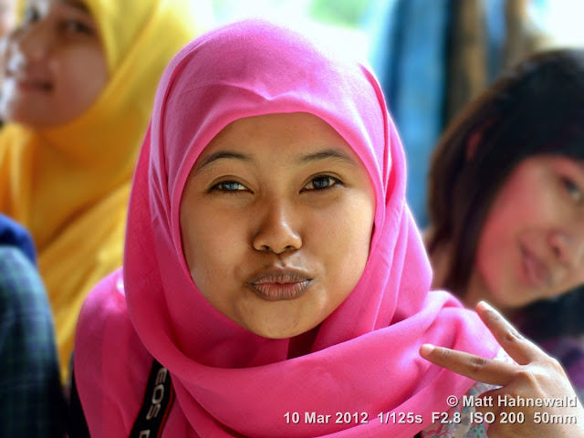 people; Muslim girl; street portrait; headshot; Indonesia; Sumatra; Medan; beauty; hijab; puckering lips; air kiss
