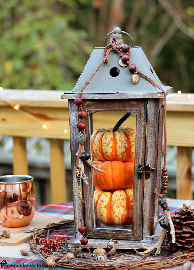 Mini pumpkins inside wooden lantern - Outdoor Fall decor