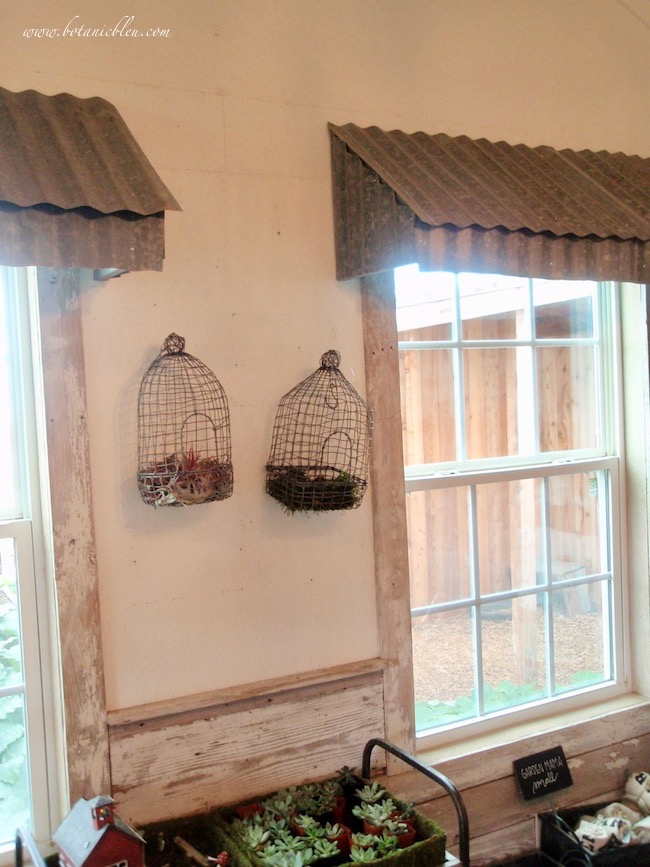 Magnolia Garden Shed Chippy White Horizontal Shiplap, Rustic Wire Birdcages, Metal Roof Window Valances