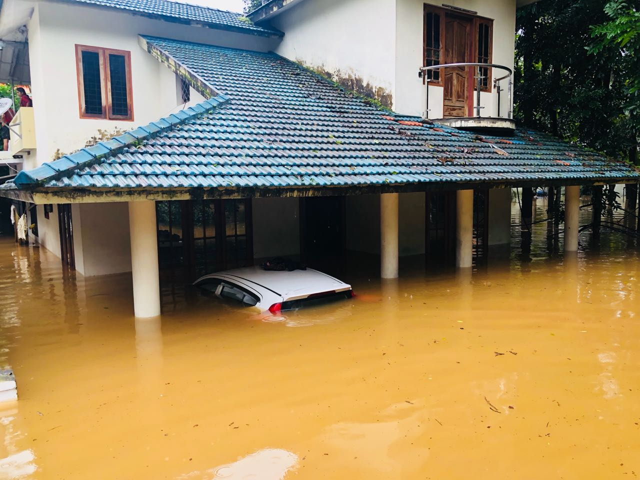 Parked car under water in Kerala Monsoons,hydro locking in Floods
