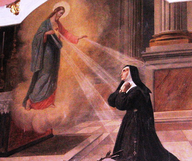 A painting of Jesus appearing to Saint Margaret Mary Alacoque in the Church of San Michele, Cortemilia, Italy