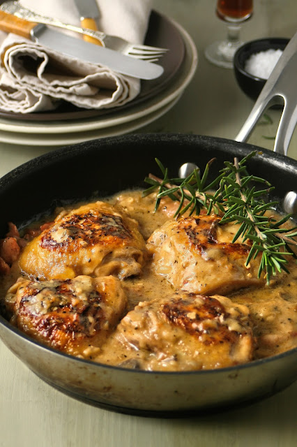 Chicken thighs in a creamy lemon and rosemary sauce.