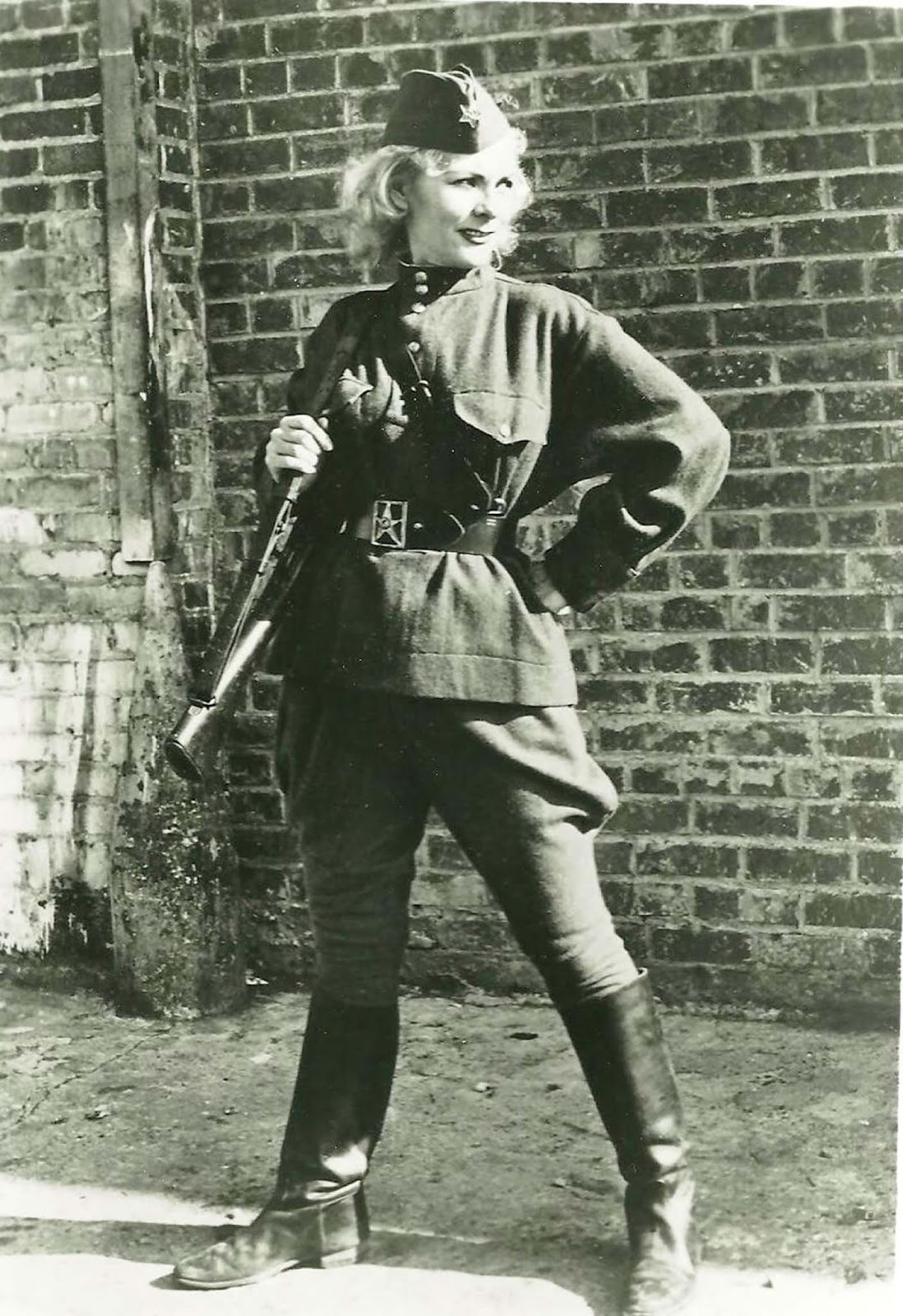 Kyra Petrovskaya was a World War II sniper. She kind of looks like Supergirl in this shot. Tough lady. If you're curious, read more about