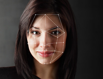 Photo showing a facial recognition scan of a woman's face.