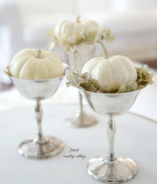 white baby boo pumpkins in silver