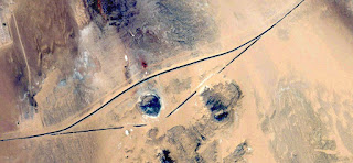 UFO drawing in the sand,imaginary roads,Abstract Naturalism,abstract photography deserts of Africa from the air,