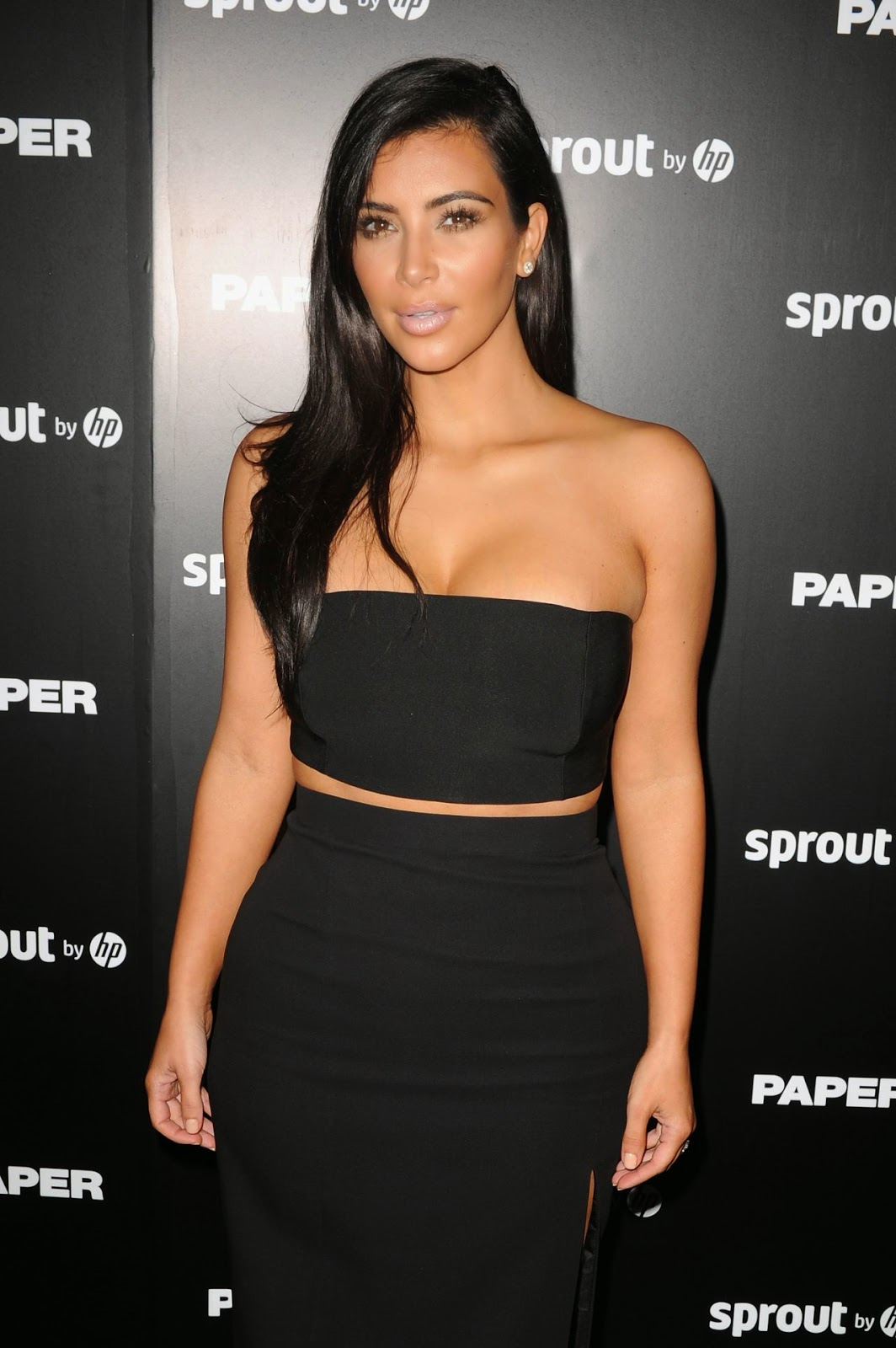 Kim Kardashian wears cropped top and skirt to the launch of her Paper magazine cover in Miami