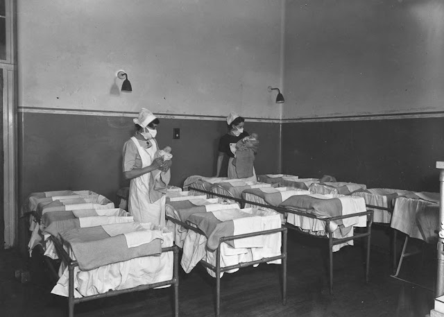 Nurses hold babies in a maternity ward at Guy's Hospital, London, 1947.