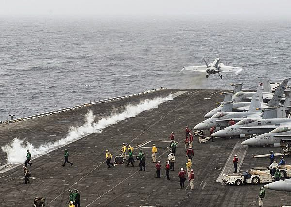 F/A-18 Super Hornet taking off from USS Nimitz 2013. Same side catapult being used as when I was out there in 1983.