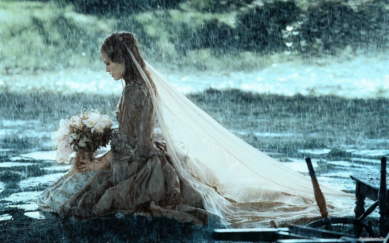 Sad lonely bride girl alone crying in rain