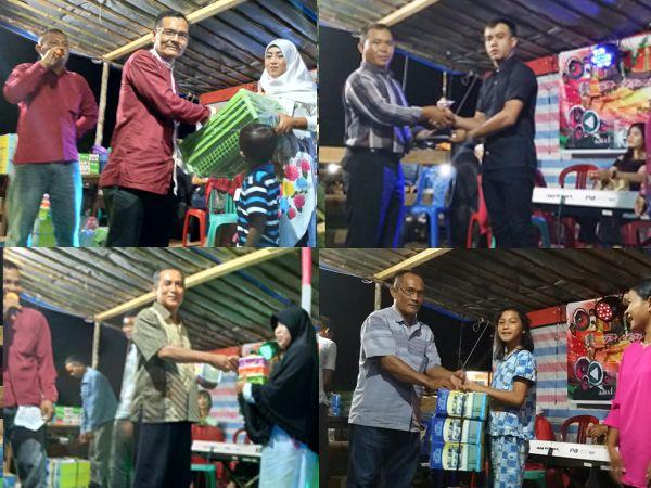 saat pembagian hadih oleh Camat Sekadau Hilir Hermanto,S.Sos.M.Si, Kades Tanjung Syamsudin, Hadi Sapriadi dan Zainal Bong