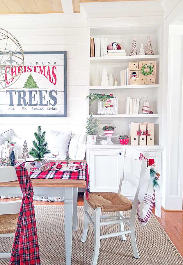 white and red Christmas decor in dining room with built-in