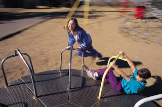 On the playground, kids enjoying physical activity.