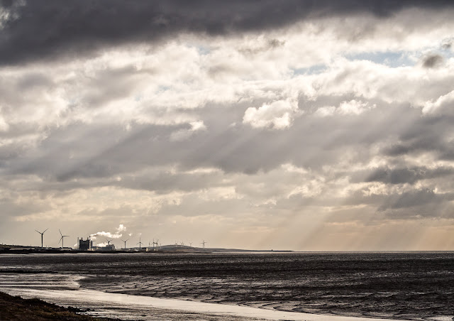 Photo of rays of light breaking through the clouds over the Solway Firth