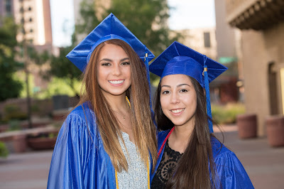 image of two Rio Salado students in commencement attire smiling