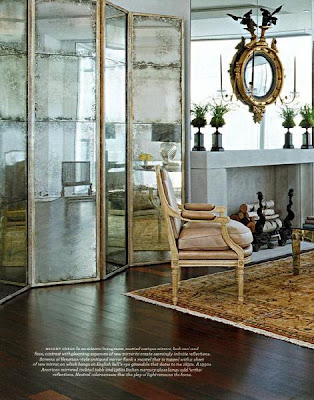 convext mirror in living room with antique mirror wall